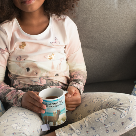 Granddaughter drinking from Guardians of the Grandchild mug