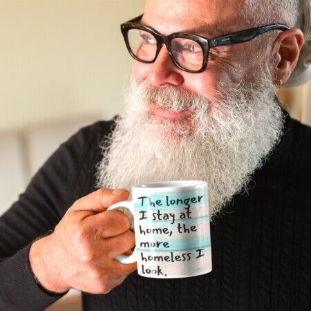 "Man holding ""Homeless"" mug"