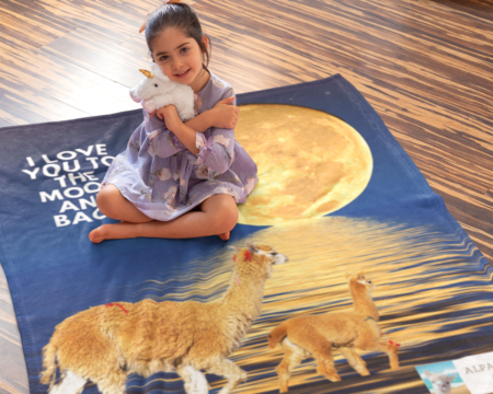 I love you to the moon and back alpaca beach gift blanket for girl on floor