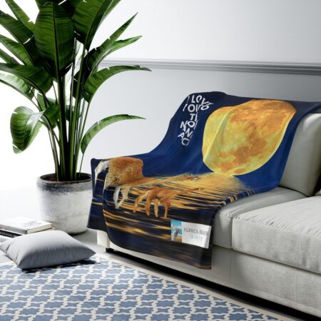 I love you to the moon and back alpaca beach gift blanket on couch