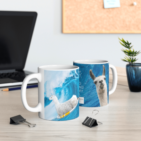 Surfing llama mug from both sides to view both llamas