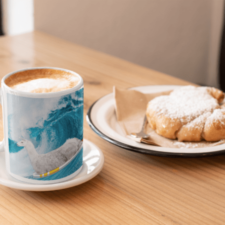 """""""Sorry, I can't. I'm going surfing with my llama funny gift coffee mug."""" next to pastry"""