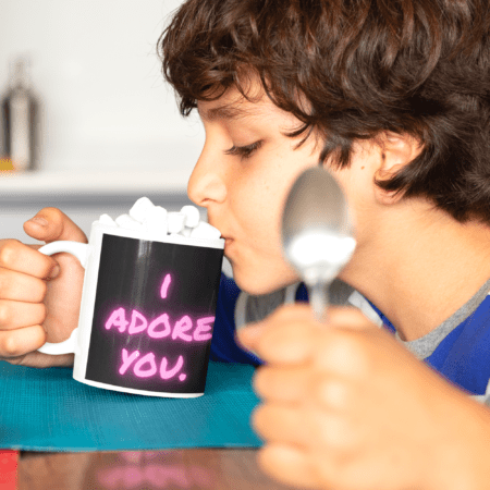 "I adore you. You are my sunshine. Alpaca Beach Gifts loving gift to child. smiling boy with mug that says ""I adore you"" drinking with marshmallows"