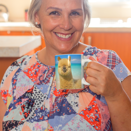 Brownies Kicked In alpaca beach gift mug, smiling woman
